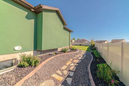 Landscaped garden pathway and suburban backyard day
