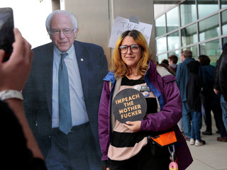 Mel Herrera-Baird has her photograph taken next to a cardboard cut-out of Democratic 2020 U.S. presidential candidate Senator Bernie Sanders at a campaign rally