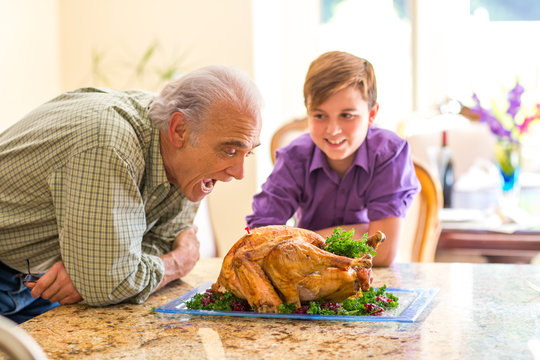 Grandfather and grandson having fun in the kitchen at the holidays