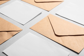 Mockups of invitations with envelopes on light background
