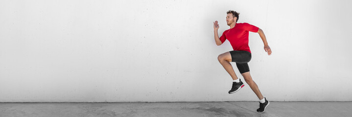 Sprint run man runner running doing jump training outdoor sprinting at gym. Fit healthy active lifestyle. Male athlete hiit high intensity interval cardio workout. Banner panorama wall background.