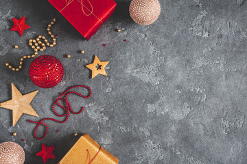 Christmas composition. Gifts, red and golden decorations on black background. Christmas, winter,...