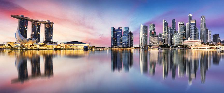 Singapore skyline at sunrise - panorama with reflection