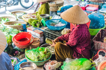 Women selling food on the street of Hoi An, Vietnam