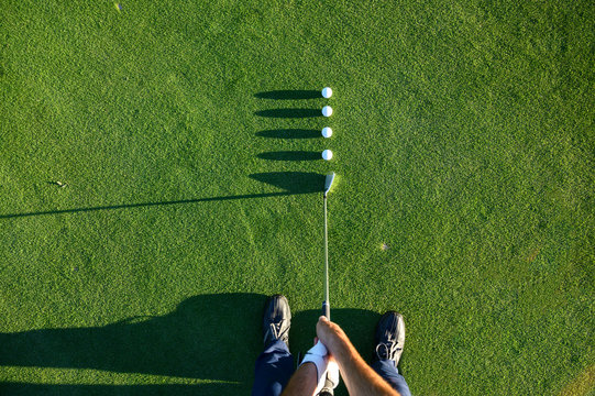 Golf balls in line while putting for accuracy
