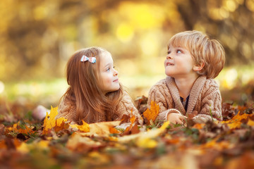 Funny twins in autumn park