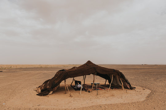 A berber camp tent in the middle of the Sahara desert.