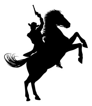 A cowboy riding a horse in silhouette waving pistol in the air