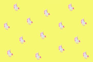 Pink unicorns on yellow backdrop.