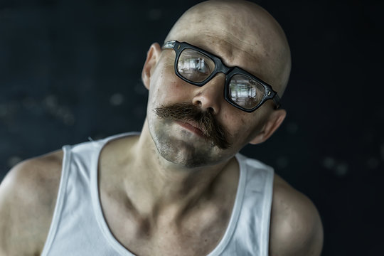 sexy macho with a mustache, freak, unusual portrait of a hipster guy