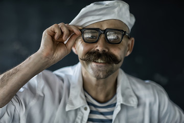 brutal cook with mustache, unusual marine chef in a vest, vintage style