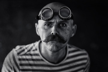 portrait of a steam punk hipster, mustachioed man posing, face, mustache