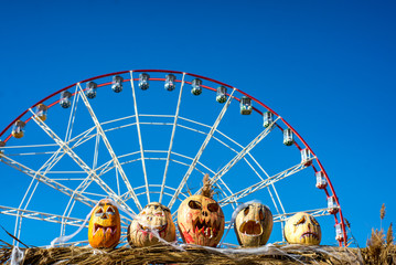 Door stickers Amusement Park halloween pumpkin on blue sky background