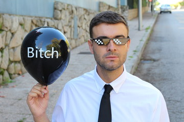 Funny pic of businessman holding a hilarious balloon