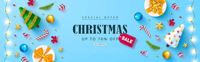 Christmas sale web banner. Holiday background with cute Christmas trees,gold stars, Rowan bunches, balls,gift boxes and candy.Vector illustration for website,posters,ads,coupons,promotional material.