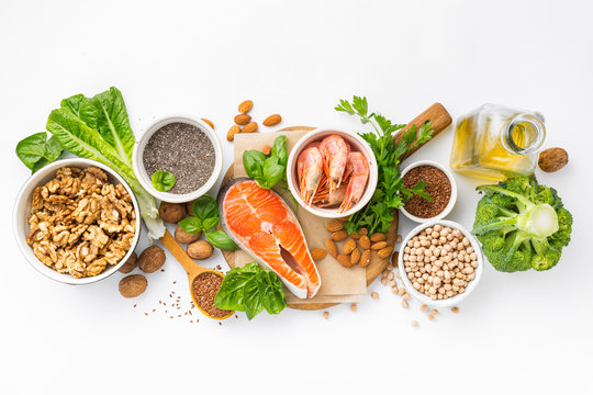 Food sources of omega 3 and omega 6 on white background top view. Foods high in fatty acids including vegetables, seafood, nut and seeds