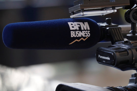 The logo of BFM Business TV is seen on a microphone during a news conference  at the Bercy Finance Ministry in Paris
