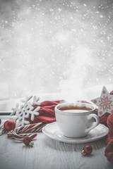Photo sur Aluminium The Winter cozy hot chocolate in front of window, snow, sweater. Lazy weekend, love, comfort