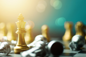 winner of chess game board, golden victory king win in successful business competition