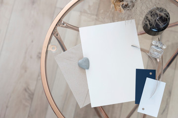 Object mock up image. White blank paper in fancy modern inetior. Nobody on photo. Space for text