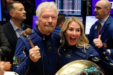 Sir Richard Branson poses on floor of New York Stock Exchange with Future space traveller Jennifer Rallison from Canada as Virgin Galactic (SPCE) begins public trading in New York