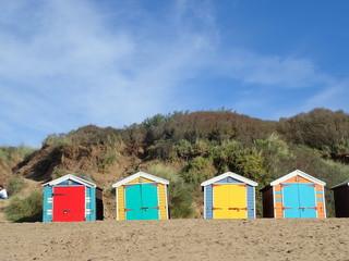 Colourful beach huts at Saunton