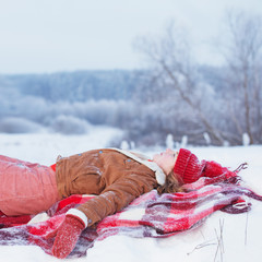 teen girl on plaid in snow