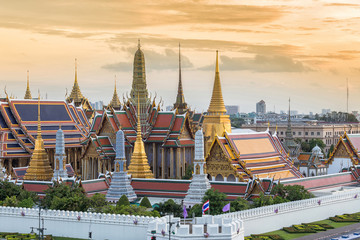 Wat Phra Kaew or Temple of the Emerald Buddhath and The Grand Palace at sunset in Bangkok Thailand. Wat Pra Kaew is a Buddhist temple, Wat Pra Kaew is among the best known of Thailand's landmarks.