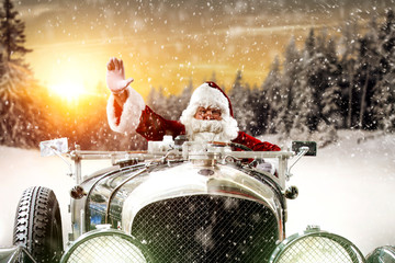 Red old Santa Claus in green retro car and free space for your decoration.