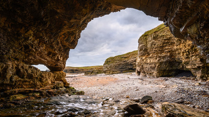 Caves at Pebbled Beach, in a cove known as The Wherry, among Magnesian Limestone Cliffs just south of Souter Lighthouse which is full of caves and sea stacks