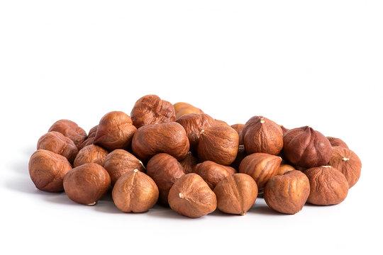 Hazelnuts without shell on a white background, isolated. Pile of hazelnut closeup.