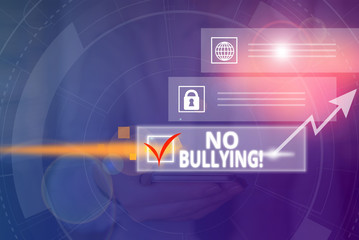 Conceptual hand writing showing No Bullying. Concept meaning stop aggressive behavior among children power imbalance Picture photo network scheme with modern smart device