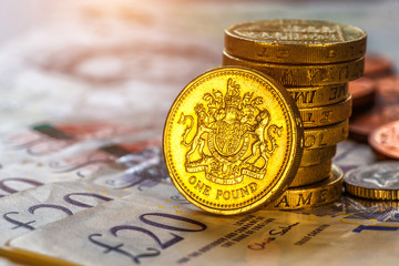 British coins stack on black, pound sterling,Business concept