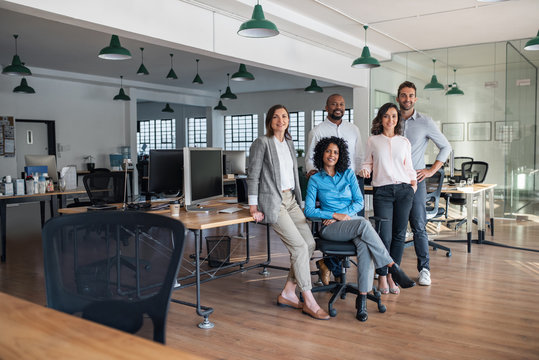 Diverse group of smiling businesspeople working in an office