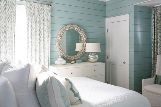 Modern beach house bedroom with teal walls