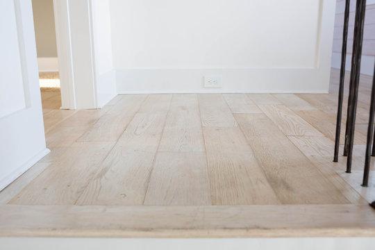 Blonde hard wood floors in home