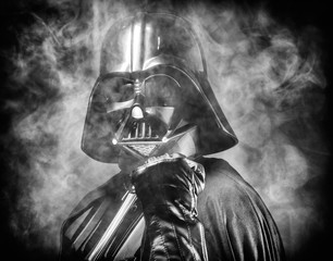 SAN BENEDETTO DEL TRONTO, ITALY. MAY 16, 2015. Close up of  helmet of Darth Vader costume replica with fist punch . Darth Vader is a fictional character of Star Wars saga.  Black and white picture