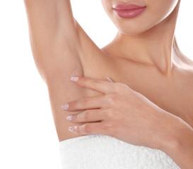 Young woman showing armpit on white background, closeup. Epilation procedure