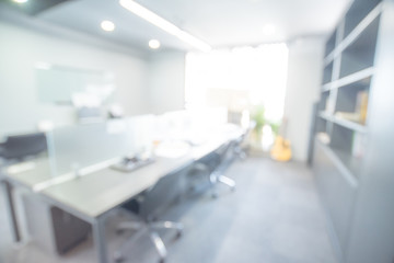 Abstract blurred office hall interior room. Blurry corridor in working space with defocused effect. Use for background or backdrop in business concept