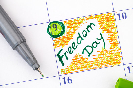 Reminder Freedom Day in calendar with green pen.