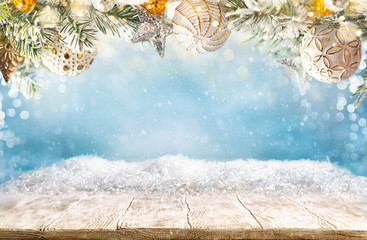 Photo sur Aluminium Bleu clair Beautiful winter background with wooden old desk and blurred blue sky. Winter, New Year and Christmas concept with snowy background.
