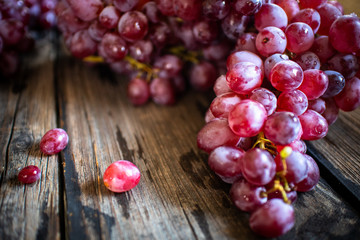 fresh organic red grape on old wooden vintage table