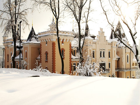 Winter tale. New Year celebration. Beautiful building in castle style in winter. Winter view of snow covered castle in the central park in the city