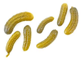 Pickled cucumbers isolated on a white background, top view. Cornichons.