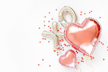 XO foil balloon letters and air balloons of heart shaped. Love concept. Holiday and celebration. Valentine's Day or wedding/bachelorette party decoration. Colorful Metallic  air balloons.