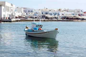 small traditional fishing boat in the port of Mykonos, the famous Greek island of Cyclades in the heart of the Aegean Sea