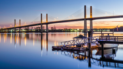 Vancouver, British Columbia - Canada. The Golden Ears Bridge, connecting Maple Ridge to Langley. Long exposure at night, Sky and bridge reflecting into Fraser River. Fototapete