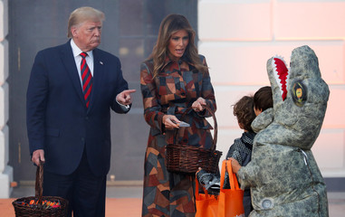 U.S. President Trump and first lady hand out candy to schoolchildren in advance of Halloween in Washington