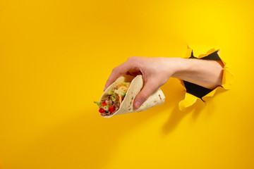 Hand giving a taco Wall mural