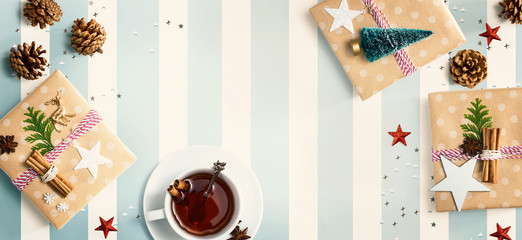 Christmas gift boxes with a cup of tea - flat lay